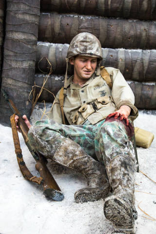 Wounded Marine Behind a Trench