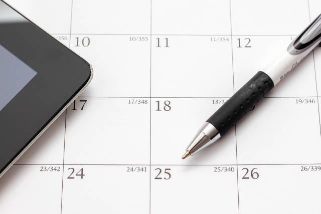 Calendar Closeup with Pencil and Tab