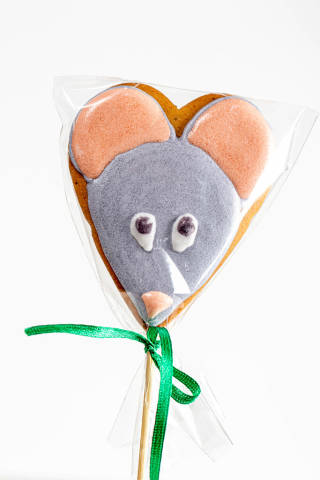 Gingerbread mouse figure on a wooden stick