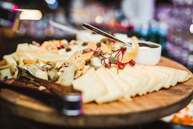 Cheese Plate Asorti With Bokeh Lights