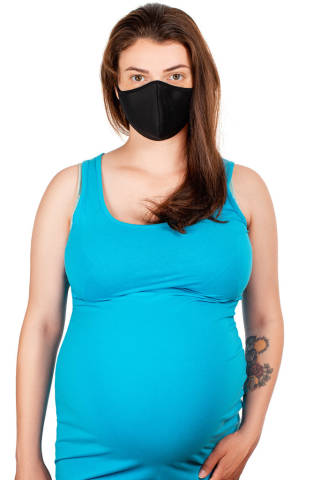 A pregnant woman in a black medical mask. Concept of health care and protection of yourself and your child