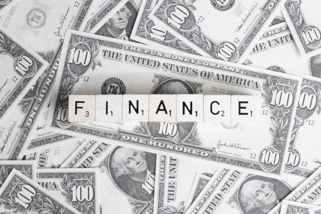 Pile of cash with text Finance