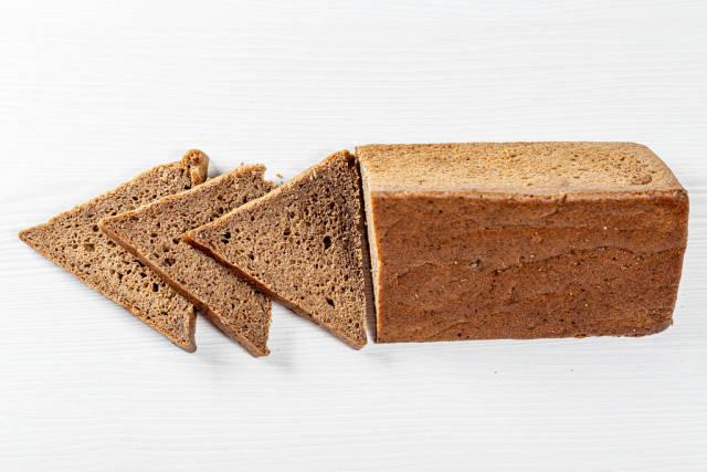 Rye bread triangular shape on white background
