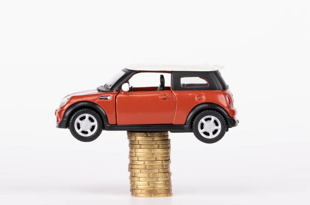 Toy car on stack of coins