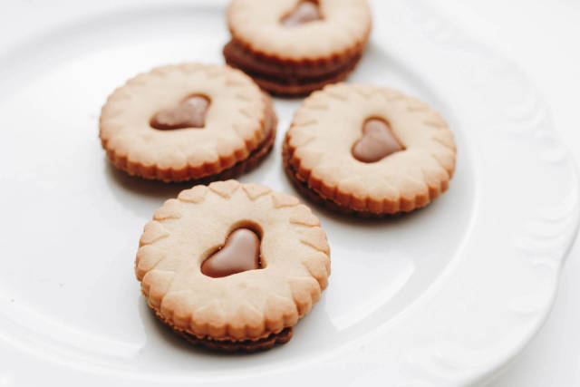 Close up of group of biscuits with chocolate hearts