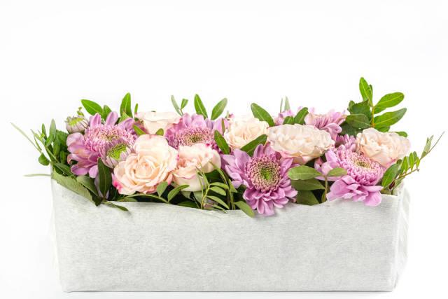 Pink eustoma and purple chrysanthemum flowers