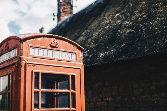 Vintage Red telephone box. English country side.