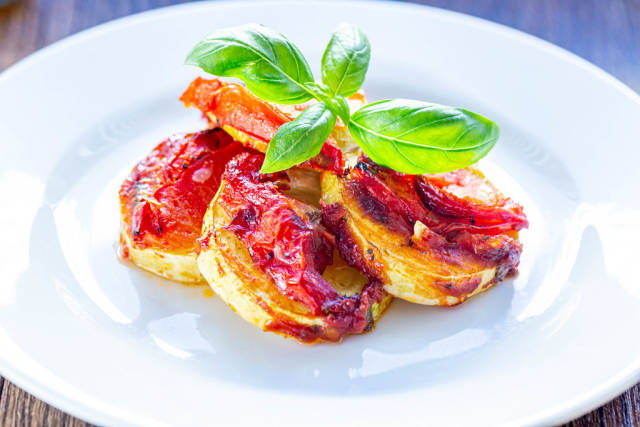 Baked zucchini with tomatoes and Basil