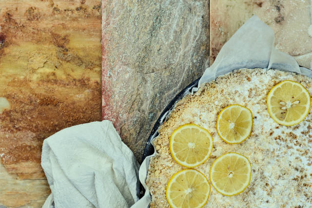 Overhead view of delicious homemade lemon cheesecake on marble background