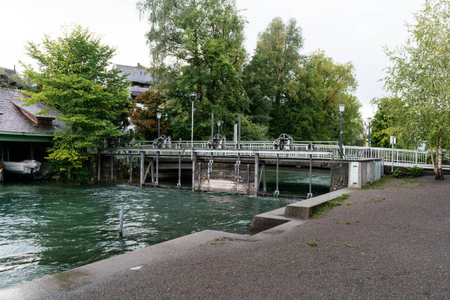 Boat gate under the bridge over a canal in Swiss city Cham