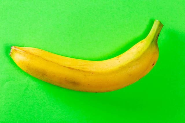 Fresh banana on green background. Top view