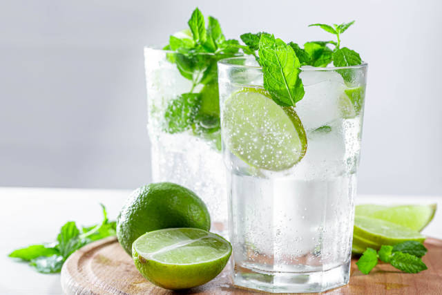 Mojito cocktail with ice cubes and fresh lime