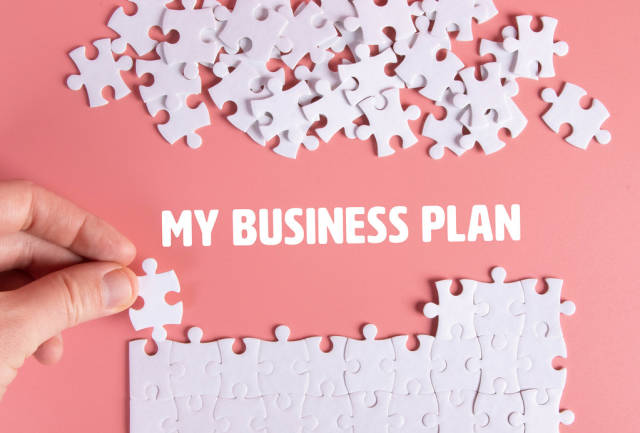 Puzzle pieces with My Business Plan text