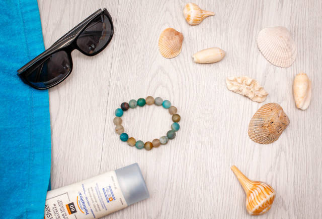 Summer Background with Shells, Bracelet, Sunglasse and Sunscreen top View