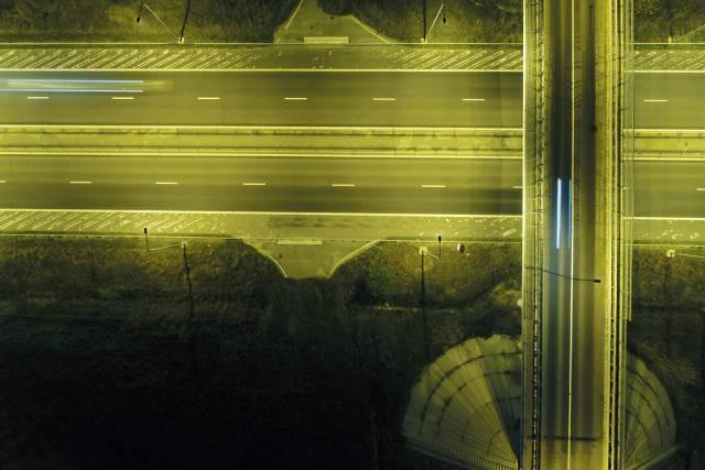 Aerial view of bridge over highway, night view