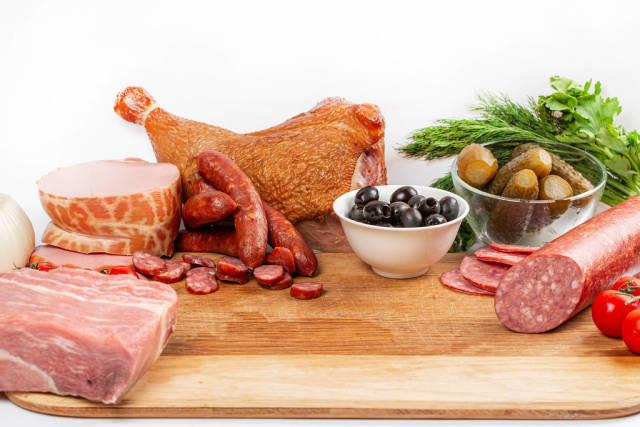 Raw and smoked meat, sausages, vegetables-the concept of the process of cooking solyanka