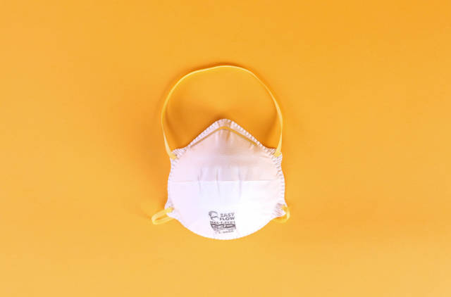 Face mask on a orange background