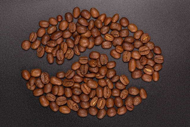 Roasted coffee beans on a black background