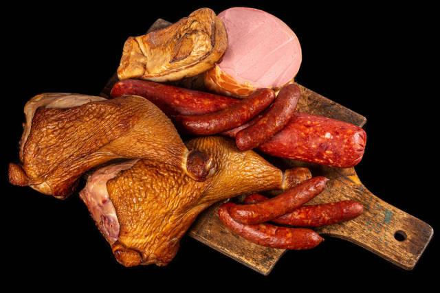Set of smoked salami, chicken legs, lard and sausage