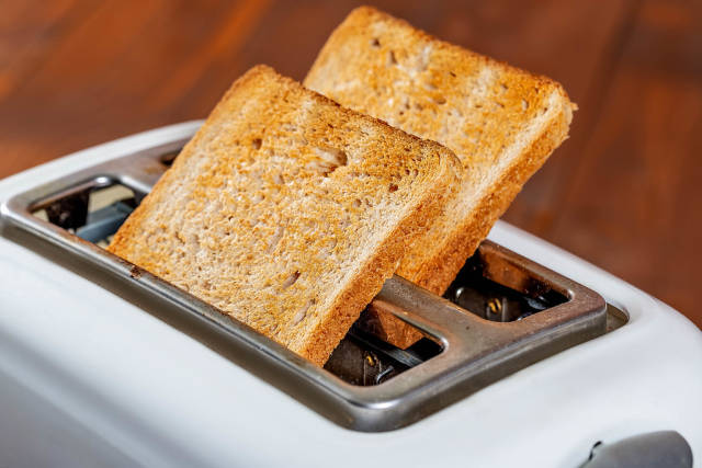 Two slices of baked bread on the toaster