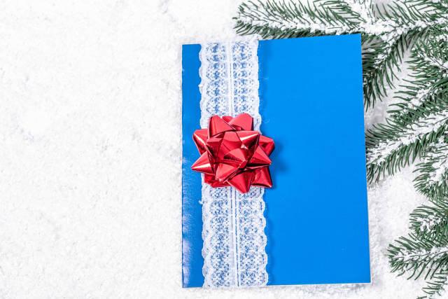 Cheerful handmade Christmas card on winter new year background