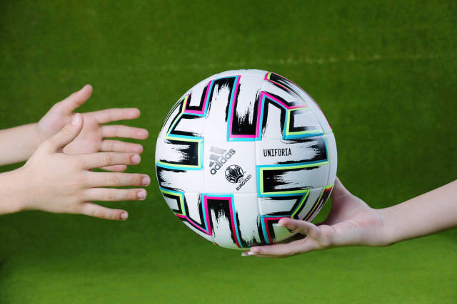 Uniforia ball in hands of supporters, EURO 2020, green background