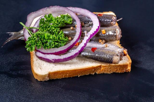 Sandwich with marinated ryboyna black background