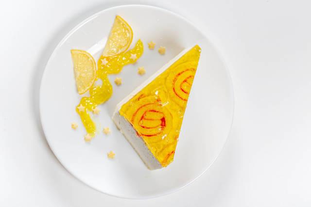 Top view lemon cake on a white plate
