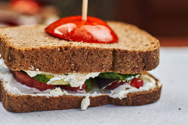 Close-up view of sandwich made with wheat bread and organic vegetables