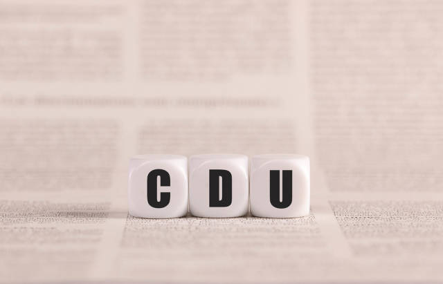 CDU written with cubes on a newspaper