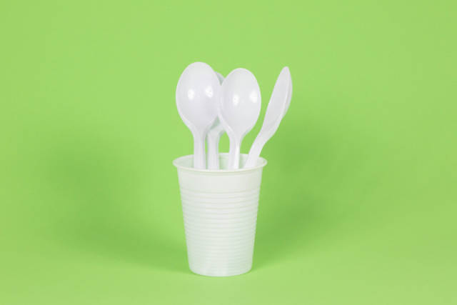 Plastic spoons in a cup