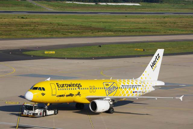 Eurowings, Hertz livery plane, D-ABDU being towed on CGN Koln Bonn Airport