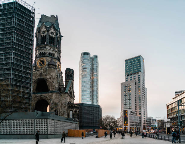 Ruined church of Kaiser Wilhelm next to high-rise buildings in downtown Berlin