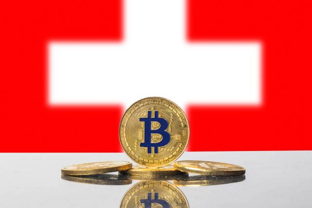 Golden Bitcoin and flag of Switzerland