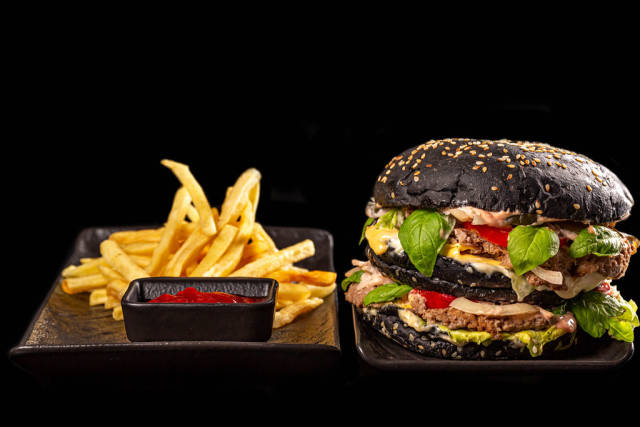 Fresh black hamburger and fries