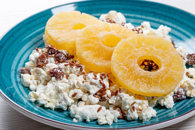 Close up of cottage cheese with flax seeds and dried pineapple rings