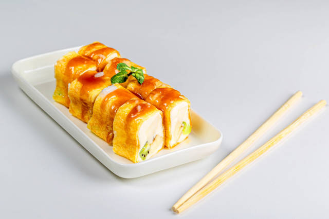 Set of sweet rolls with cheese and fruit on a white background with chopsticks