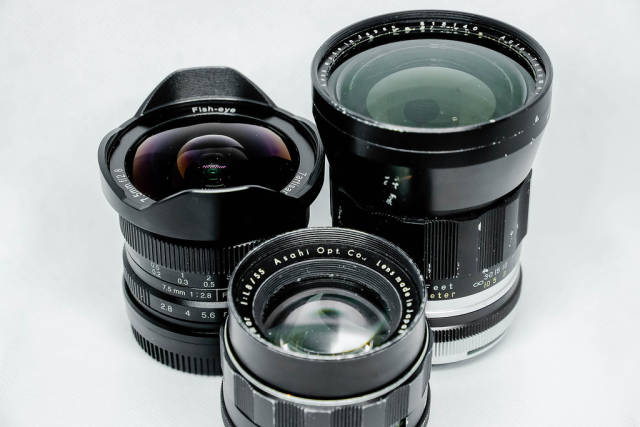 Another shot of old vintage lenses on white background