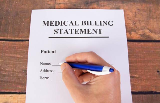 Man filling out medical billing statement