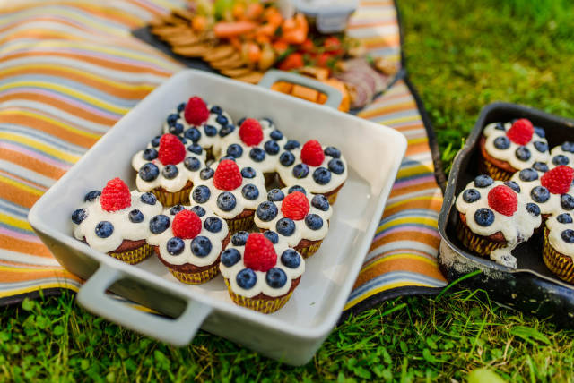 Picnic With  Cream Cupcakes  On The Grass