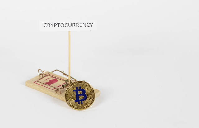 Mausefalle mit Bitcoin Münze als Köder