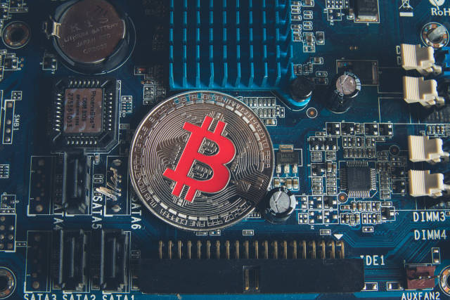 Silver Bitcoin on a Mother board