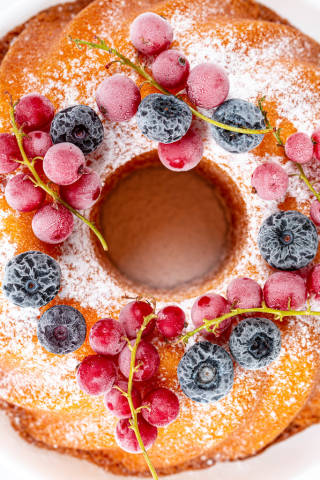 Top view, cupcake with powdered sugar and berries