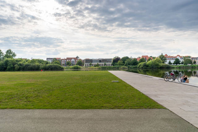 Green lawn in the park next to the lake and Schwerin Castle in the beautiful city of Schwerin