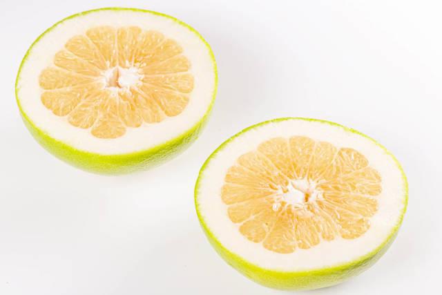 Two halves of fresh ripe sweetie fruit
