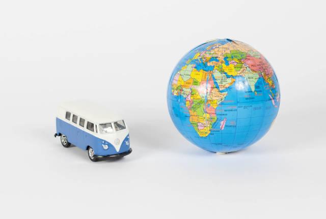 Vintage camper van with globe