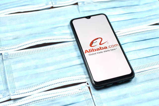 Alibaba - chinese company logo on mobile phone screen. Coronavirus crisis changing global business rules