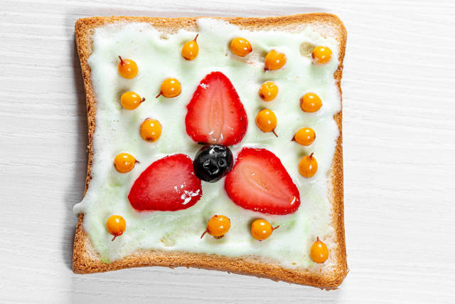 The view from the top of the sandwich with sea-buckthorn berries, blueberries and strawberries