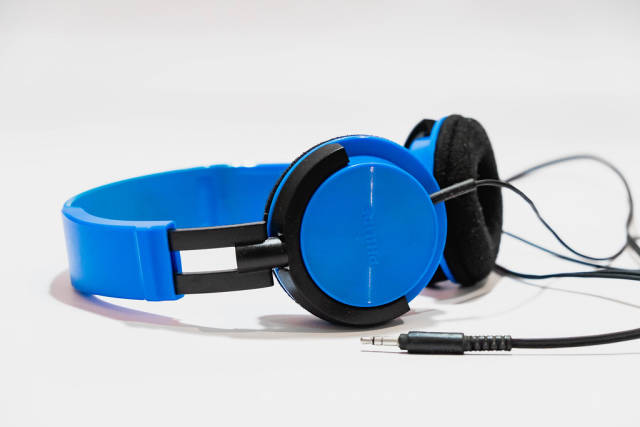 Vibrant blue headphones on white background