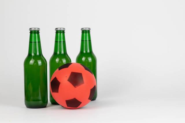 Bottles of fresh beer with soccer ball